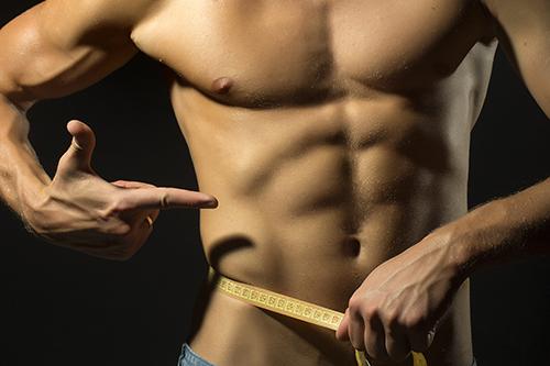Slim body treatments in Orange County - Man Measuring Body